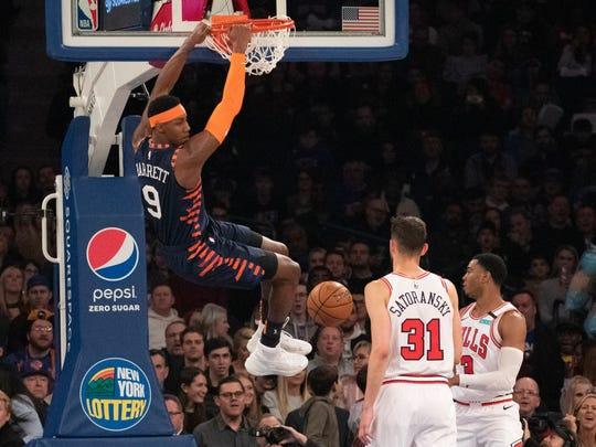 New York Knicks guard RJ Barrett (9) dunks over Chicago Bulls guard Tomas Satoransky (31) during the first half of an NBA basketball game, Saturday, Feb. 29, 2020 in New York. (AP Photo/Mark Lennihan)