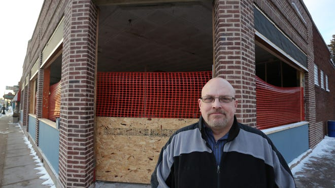 Owner Chad Hoffer stands outside of what will be North Abbey Brewing Co. in Mosinee in January. Hoffer is looking for an investor to help him finish work on the building to open the brewpub.