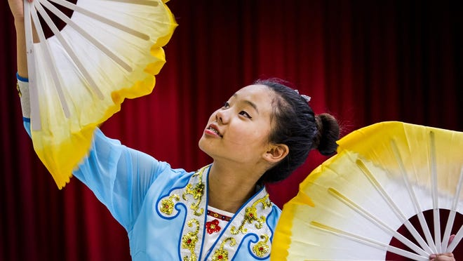 Katelyn Tsai rehearses a traditional Chinese dance in preparation for the Chinese Festival at the Chinese-American Community Center in Hockessin, Delaware, on Monday afternoon.