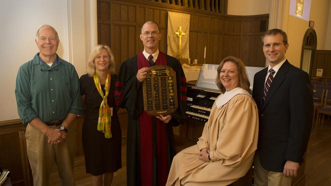 United Methodist Church in Madison capital campaign committee members Vic Schumacher (left to right) and Jeanne Eisele, Pastor Robb Shoaf, Director of Music Susan McAdoo and campaign chairman Stewart Robinette with the refurbished 1924 Austin Organ, which was updated as part of a recent capital campaign.