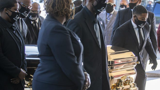 George Floyd's casket is carried from a hearse into the Fountain of Praise church in Houston before the start of Monday's public viewing.