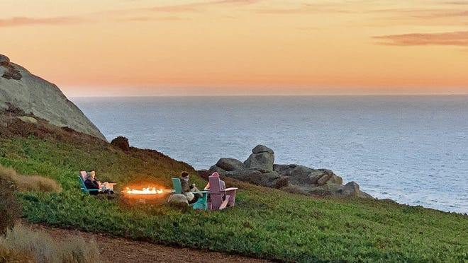Lounging by the firepit at sunset at Timber Cove Resort in Jenner, California.