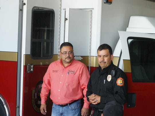 Palomas Mayor Ramon Rodriguez, left, looked on as Columbus Fire Chief Andres Ramos presented Puerto Palomas with an ambulance and donated rescue equipment on August 18.