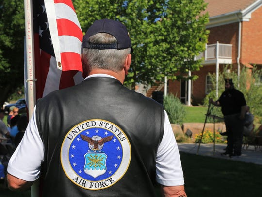 A member of the Patriot Guard Riders listens to Calvin Fox, post commander for American Legion Post 912, during a Memorial Day service on Monday at Veterans Park in Washington City.