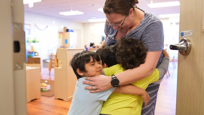 Samantha Coontz, director of Sunshine House, gets a group hug from Luke Prince and his friends on Wednesday February 15, 2017.