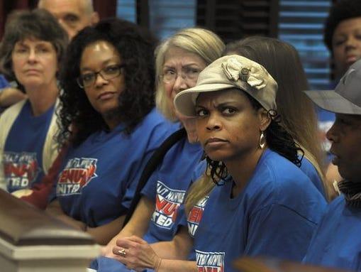 Jihada Sias listens to Tom Davis of the Davidson County