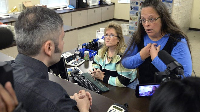 Rowan County Clerk Kim Davis, right, talks with David Moore following her office's refusal to issue marriage licenses at the Rowan County Courthouse in Morehead, on Sept. 1.