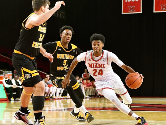 MU's Michael Weathers drives to the hoop against NKU.