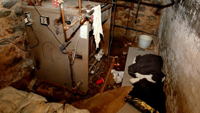 This Oct. 17, 2011 file photo shows the sub-basement room in Philadelphia where four weak and malnourished mentally disabled adults, one chained to the boiler, were found locked inside.  Linda Weston, accused of keeping mentally disabled adults captive in the basement for their disability checks, was sentenced Thursday to a life in prison.
