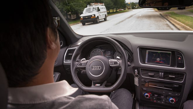 This is the interior of an Audi SQ5 that is equipped with an autonomous driving system developed by Delphi Automotive and Mobileye.