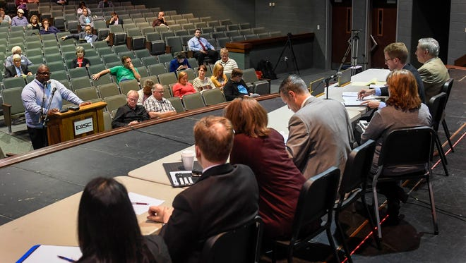 Rev. Larry Rasco with the Nazarene Missionary Baptist Church testifies before the Indiana Utility Regulatory Commission on the Vectren plan to spend $500 million to upgrade its electrical grid, that will call for incremental rate increases, during a hearing Tuesday, May 2, 2017.
