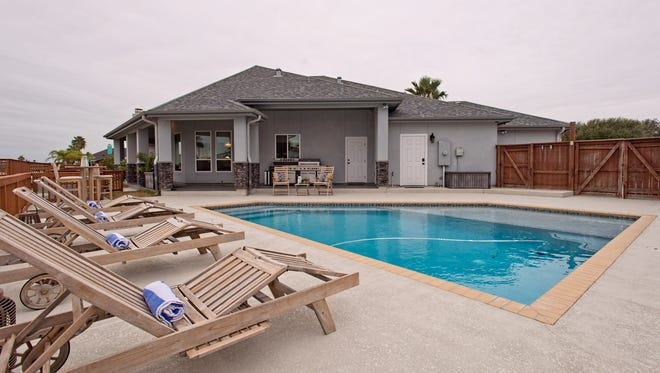 Check out the beautiful pool overlooking a Padre Island canal.  The Bradford's home is one of a kind,  built it to entertain friends & family in style and comfort.