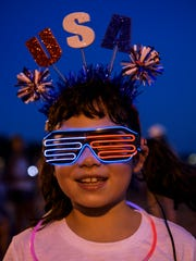 Maysa Phillips, 7, shows off her glowing sunglasses