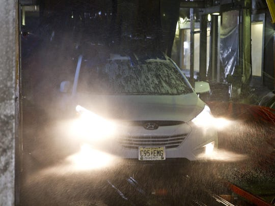 A car goes through the wash at Butch's Lube 'N Wash in Red Bank.