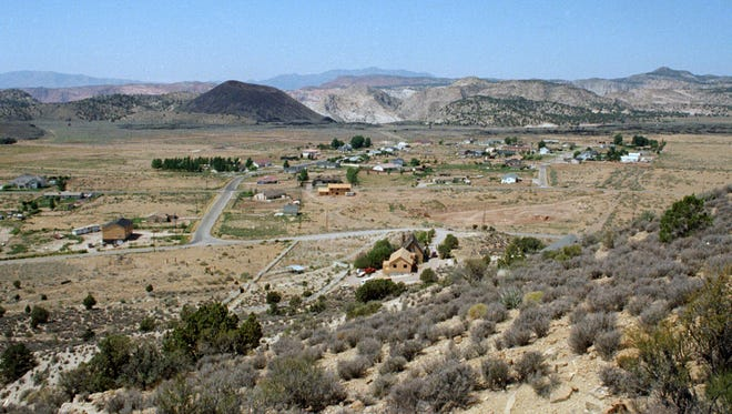 In August of 1996 Spectrum and Daily News photographer Jud Burkett took the then image looking out over Diamond Valley. Much has changed in Diamond Valley in the nearly 20 years since the then image was taken. In addition to the dozens of new homes in Diamond Valley, Diamond Valley Elementary School was built, along with the fire station and the Church of Jesus Christ of Latter-day Saints building along Diamond Valley Road all of which can be seen in the now image, also taken by Jud Burkett.