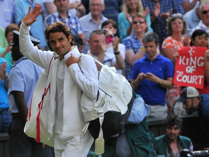 Switzerland's Roger Federer leaves Central Court after winning his men's singles semi-final match against Canada's Milos Raonic on day 11 of  the 2014 Wimbledon Championships at The All England Tennis Club in Wimbledon, southwest London, on July 4, 2014. Federer won 6-4, 6-4, 6-4.