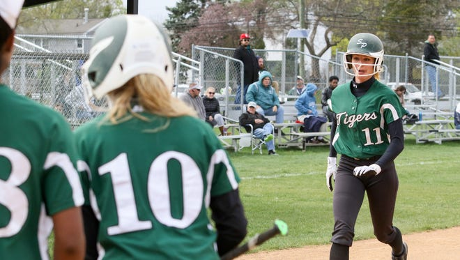 South Plainfield's Caity Hughes scores after hitting a solo home run in the first inning against Sayreville on April 19, 2017.