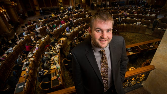 """Rep. Jake Highfill, 24, is the youngest member of the Iowa Legislature. He caught the politics bug after helping with a friend's unsuccessful city council campaign. """"I thought 'if you're going to make a difference, make a difference now,' """" he said."""