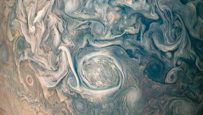 An image captured by NASA's Juno spacecraft features swirling cloud formations on Jupiter.