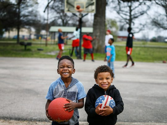 """Damani Coleman, 5, (left) and D'Marious Buchanan, 3, play at """"The Woodz,""""  the courts where University of Kentucky standout freshman Malik Monk shined during his early years in Lepanto, Ark."""