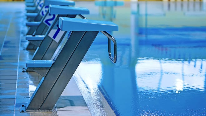 High school girls swimming.