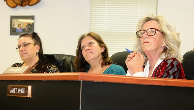 In this Jan. 12, 2017 file photo, Otero County Commissioners from left to right, Lori Bies, Susan Flores and Janet White listen attentively to a topic discussed at their meeting.