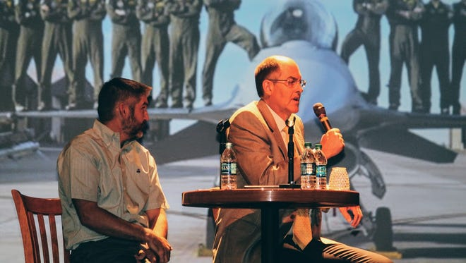 From left to right, TDY Task Force Vice-Chairman Joshua Ramsey and TDY Task Force Chairman Bob Pattillo speak to audience members at the Flickinger Center for Performing Arts  Wednesday about a new nonpartisan group called MainGate United that provides unconditional support for the missions at Holloman Air Force Base, White Sands Missile Range and Fort Bliss.