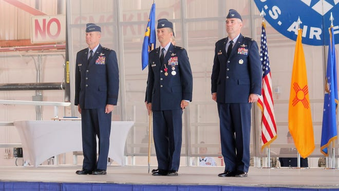 Lt. Gen. Mark D. Kelly, 12th Air Force commander, Col. Houston Cantwell, outgoing 49th Wing commander and Col. Joseph L. Campo, 49th Wing commander, stand before a change of command ceremony early Friday morning at Holloman Air Force Base.