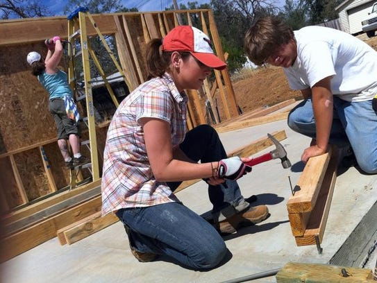 Tess Kersten (left) and R.J. Ellicock help build a