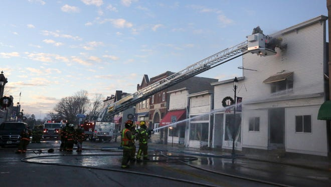 Firefighters from various departments battle a fire in the 200 block of W. Main Street in Hortonville, Wis., Sunday, November 29, 2015.Ron Page/Post-Crescent Media