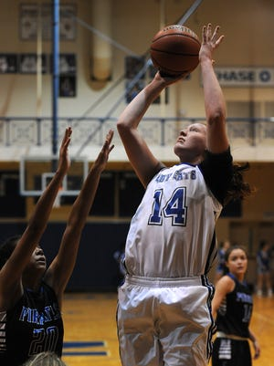 North Harrison's Lilly Hatton (14) shoots against Charlestown on Saturday at North Harrison High School. (Photo by David Lee Hartlage, Special to The Courier-Journal) Nov. 12, 2016