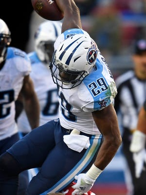 Titans running back DeMarco Murray (29) is tackled by 49ers cornerback Adrian Colbert (38) during the second half Sunday.