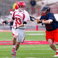 Connor Buczek, shown in action last season against Virginia, is one of three players from Cornell named to the initial watch lists for the Tewaaraton Award, given to the top player in college lacrosse. Matt Donovan was also named to the men's watch list, while the Big Red's Lindsay Toppe was named to the women's list.