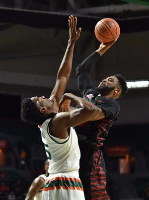 DJ Laster #25 of the Gardner Webb Runnin Bulldogs shoots during the first half against the Miami (Fl) Hurricanes at The Watsco Center on November 10, 2017 in Miami, Florida.