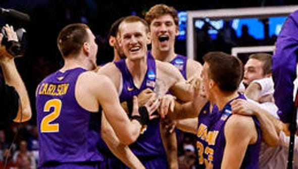 Merrill native Paul Jesperson, middle, signed a professional