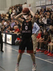 NFC's Trent Phillips shoots a 3-pointer during a District