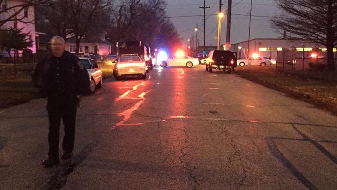 IMPD officers swarm to a shooting scene in the 1800 block of North Harding Street on Wednesday, March 25, 2015.