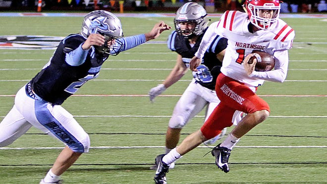 Northside's Matt Hollenbeck, right, rushes against Southside in the first quarter, Friday, Nov. 8, 2019, at Jim Rowland Stadium.