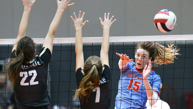 Southside's Avery Fitzgerald, from right, hits a kill shot past Bentonville's Taylor Shapley and Maddie Breed during the third set on Saturday, Nov.2, 2019 during the 6A state volleyball tournament final in Hot Springs.
