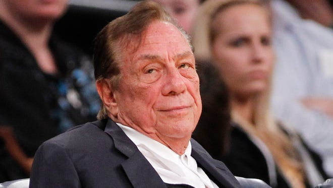 Los Angeles Clippers owner Donald Sterling watches the Clippers play the Los Angeles Lakers during an NBA preseason basketball game in Los Angeles.