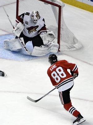 Chicago Blackhawks right wing Patrick Kane (88) scores a goal on Arizona Coyotes goalie Mike Smith (41) during the second period of an NHL hockey game Thursday, Feb. 23, 2017, in Chicago.