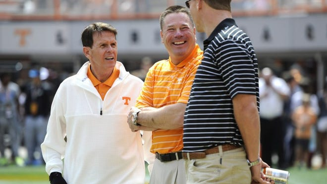 Tennessee athletic director Dave Hart, Tennessee head coach Butch Jones, and quarterback Peyton Manning, from left, share a laugh on the field before the Orange & White game at Neyland Stadium on Saturday, April 25, 2015 in Knoxville, Tenn.