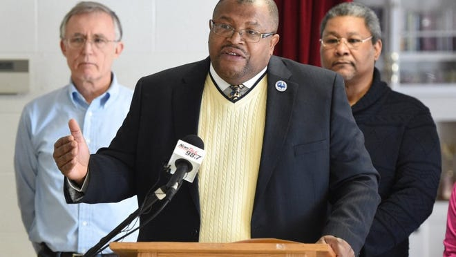 """The Rev. John Butler, Knoxville NAACP chapter president, center, speaks during a news conference while flanked by NAACP board members at Clinton Chapel AME Zion Church on Wednesday. The chapter recently filed a complaint with the U.S. Department of Education's Office of Civil Rights against the building of a new middle school in the Gibbs community. Virgil Hollis, OCR compliance team leader, wrote that the middle school plan would """"convert a facility (Holston Middle School) into becoming underutilized and identifiable as a school intended primarily for black students, resulting in re-segregation."""" (ADAM LAU/NEWS SENTINEL)"""
