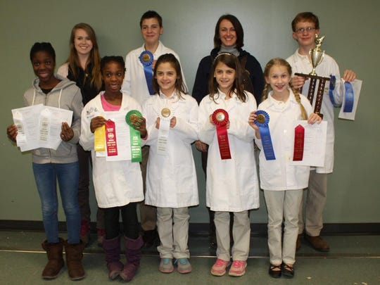 Members of the Franklin County 4-H Poultry Club  won ribbons at the Pennsylvania Farm Show (from left): front row -- Zoe Klein, Maria Klein, Adria Rheam, Joanna Rheam, Lillian Henry. Second row -- 4-H leader Hannah Boltz, Andrew Rheam, 4-H leader Cathy Bechtel and Garnet Henry.