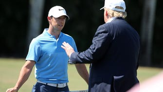 DORAL, FL - MARCH 06:  Republican presidential candidate Donald Trump makes an appearance prior to the start of play and speaks with golfer Rory McIlroy of Northern Ireland during the final round of the World Golf Championships-Cadillac Championship at Trump National Doral Blue Monster Course  on March 6, 2016 in Doral, Florida.  (Photo by Mike Ehrmann/Getty Images) ORG XMIT: 592304427 ORIG FILE ID: 514040238