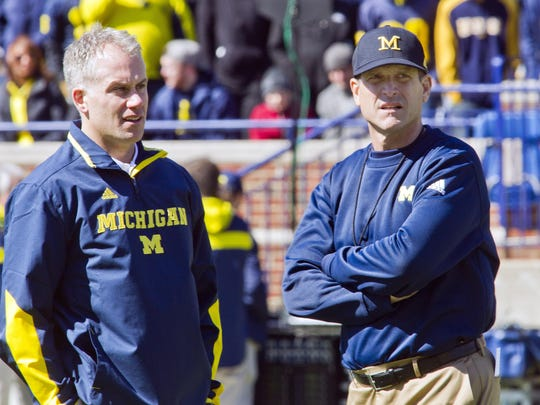 D.J. Durkin, left, is going from defensive coordinator at Michigan to head coach at Maryland. He needs to prove he can lead an entire organization. Michigan head coach Jim Harbaugh, right, already has in college and the NFL.