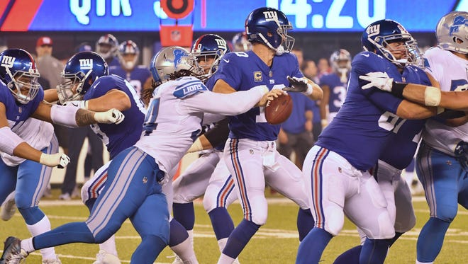 The Lions' Ezekiel Ansah knocks the ball away from Giants quarterback Eli Manning, but New York was able to recover in the third quarter.