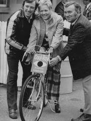 Johnny and Betty Rutherford with Indianapolis Star sports editor Bob Collins, right, before a celebrity bike race at  Indianapolis Motor Speedway.