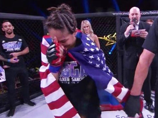 Pro MMA fighter Brogan Walker Sanchez reacts to the announcement of her unanimous decision win over Miranda Maverick at Invicta FC30 in Kansas City, Mo. on July 21.