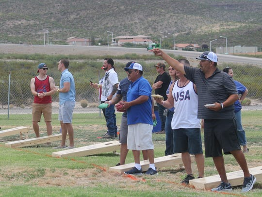 Residents participated in the Cornhole tournament at
